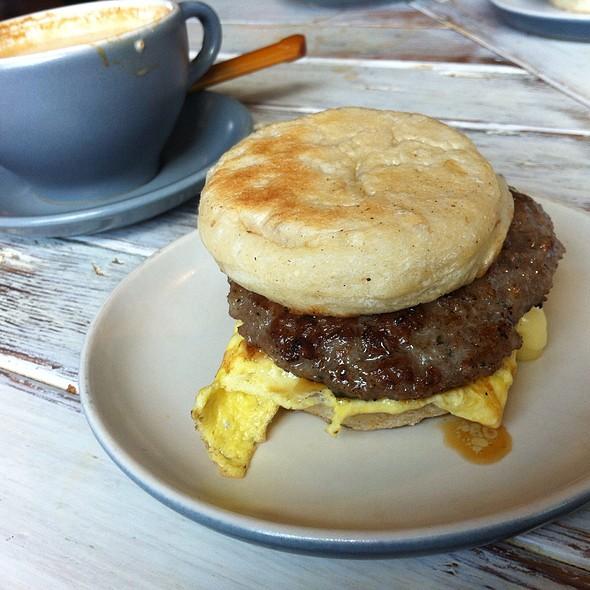 English Muffin With Sage Sausage, Egg And Cheddar @ Artifact Coffee