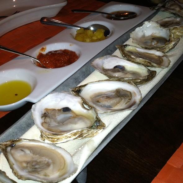 A dozen raw oysters, red onion mignonette, house made cocktail sauce, pineapple tequila vinaigrette - Moro, Wilmington, DE
