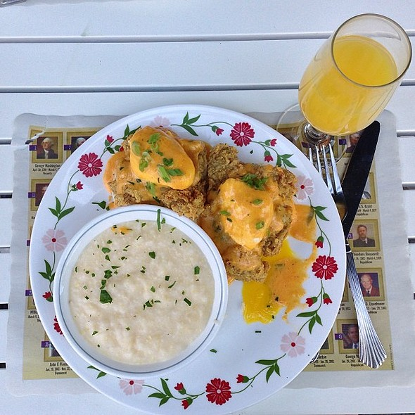 And these are what outdoor Sunday brunches are made of-- oysters eggs Benedict, grits, and mimosa @ Sugar Freak