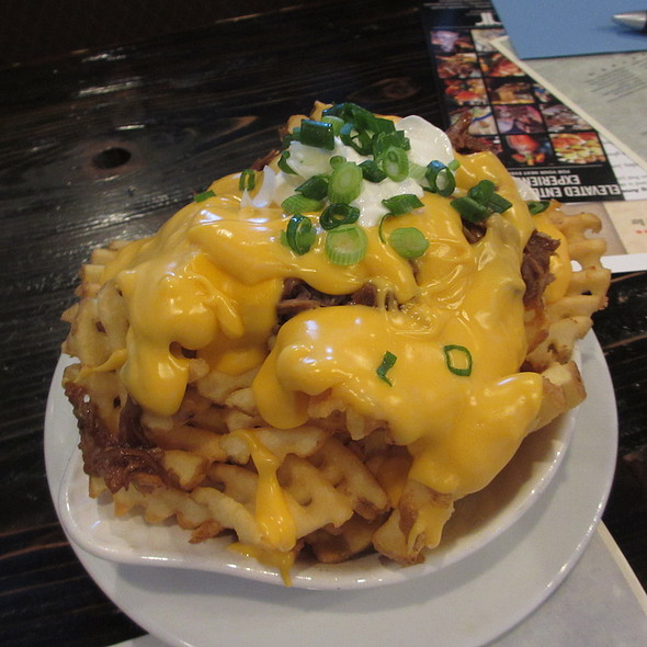 Loaded waffle fries, bbq pulled pork, nacho cheddar cheese, sour cream, scallions - Rockit Burger Bar, Chicago, IL