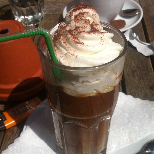 Iced Coffee With Vanilla Ice Cream And Extra Whipped Cream
