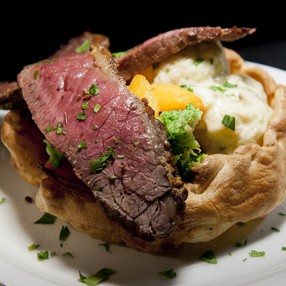 28-day aged Aberdeen Angus sirloin of beef, goose-fat potatoes, roast vegetables & cauliflower cheese in a jumbo Yorkshire pudding