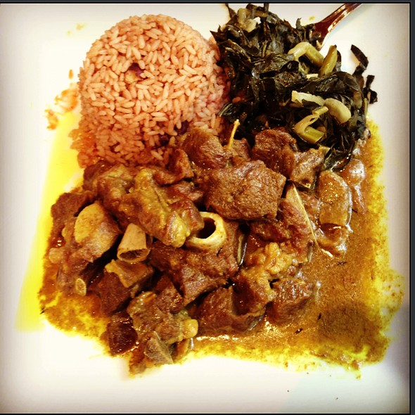 Curry goat with collard greens and plantains - Negril Village, New York, NY