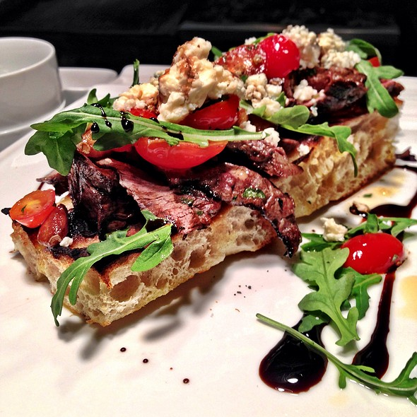 Marinated Skirt Steak On Top Of Focaccia With Roasted Garlic And Tomato Bruschetta - The Grille Fashion Cuisine, Wellington, FL