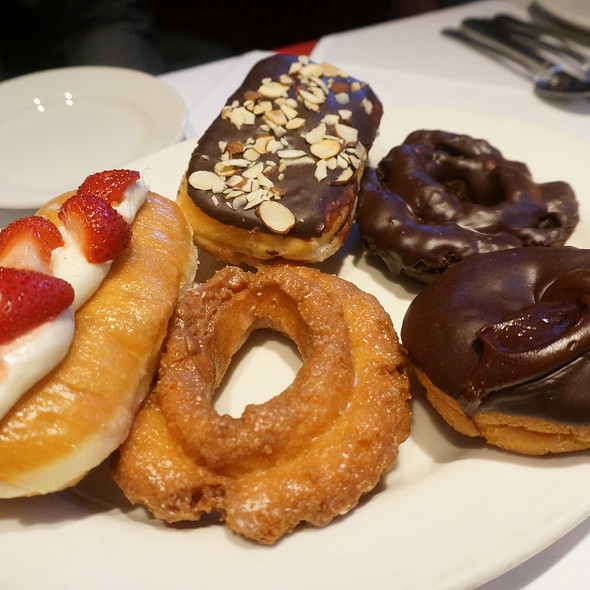 Assortment of donuts (doughnuts) - Valrhona chocolate, buttermilk old fashioned, Grand Marnier strawberries cream cheese, Double chocolate old fashioned, Boston creme pie, chocolate with almonds