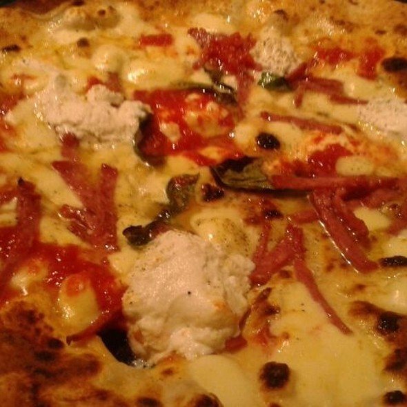 Pizza with calabrian sausage, bacon and ricotta cheese