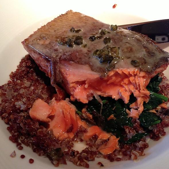 Wild Alaskan Salmon With Quinoa, Sauteed Spinach & Arugula, And A Caper Buerre Blanc