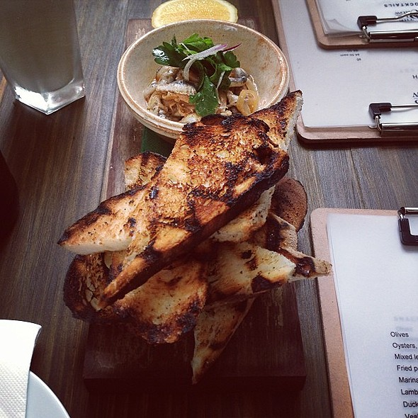 Marinated white anchovies served with charred bread. @ The Old Crow