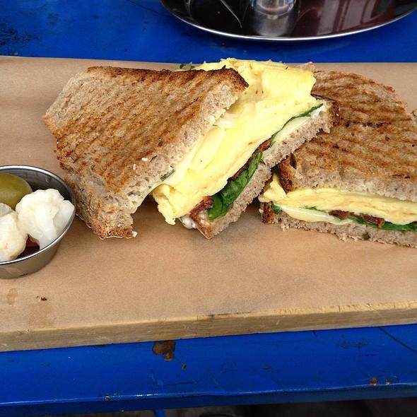 egg, bacon, gruyere and arugula sandwich