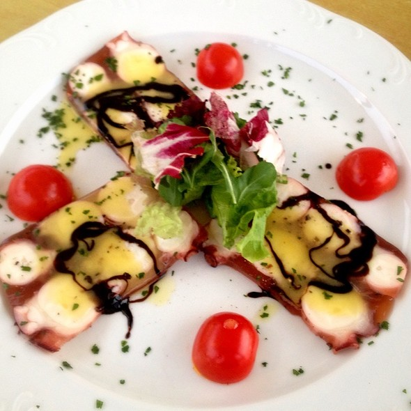 Carpaccio Octopus With Rocket Salad, Tomatoes And Caper @ Trilogia