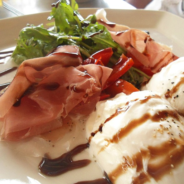 Burrata with Proscuitto, Arugula, Roasted Red Pepper, Balsamic Reduction - Vic & Angelo's - Delray Beach, Delray Beach, FL