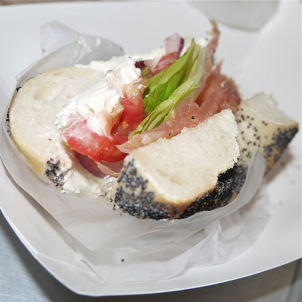 Poppy Seed Bagle with Lox, Cream Cheese, Tomato, Onions and Lettuce  @ Murray's Bagels