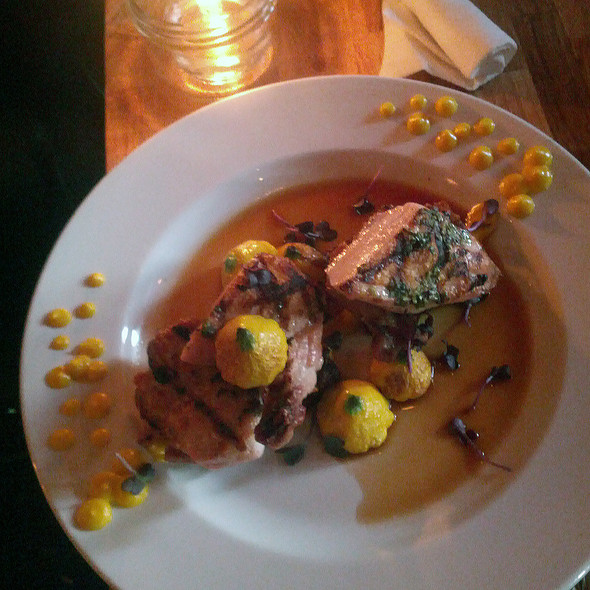 Grilled cornish game hen, bacon sage bread pudding, patty pans, carrot puree