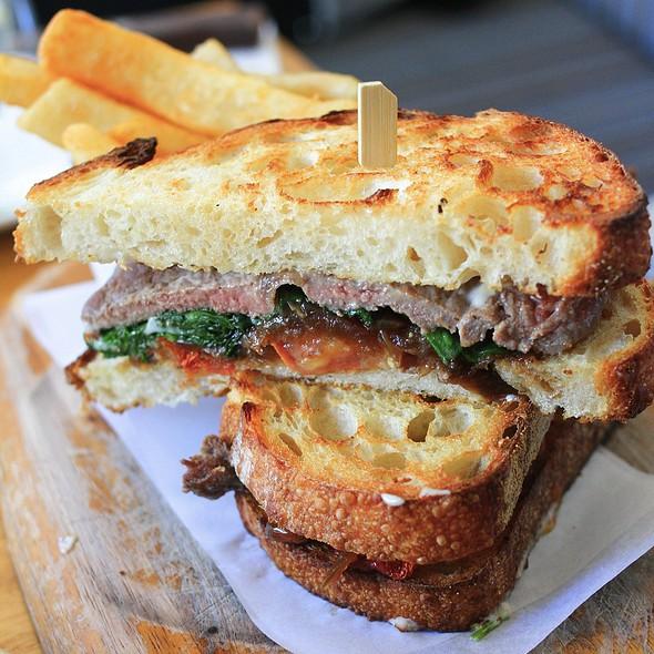 Steak sandwich, caramelised onion jam, wilted spinach, , aïoli, roasted tomatoes @ Kepos Street Kitchen