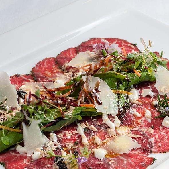 Wagyu Beef Carpaccio, Porcini Salsa, Rocket & Parmesan, Piedmont White Truffle Vinaigrette