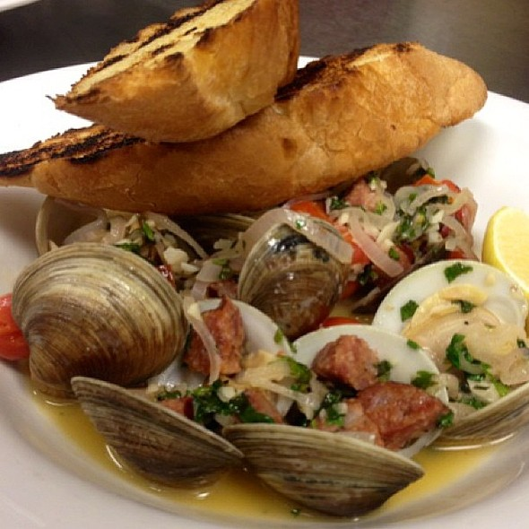Steamed Littleneck Clams with andouille sausage and garlic white wine broth.