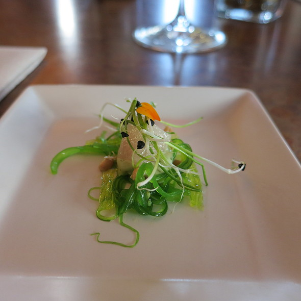 Hamachi with Sauce Diablo, sprouted wheat berries, seaweed salad, onion sprouts, edible Marigold