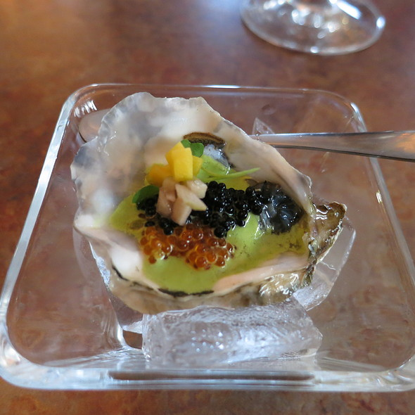 Local Miyagi oyster with Venezuelan chimichurri, two kinds of caviar including tobiko, mango, and chili smoked salt