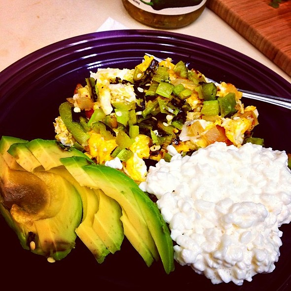 Breakfast for Dinner. Papas con huevos topped with roasted Hatch chiles, aguacate, and cottage cheese @ South Austin Neighborhood
