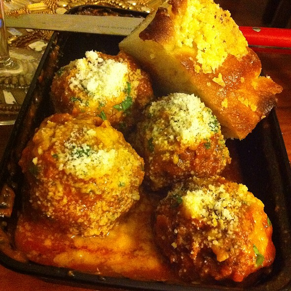 Spicy Beef And Veal Meatballs In Tomato Sauce With Parmesan Cheese And Focaccia Bread