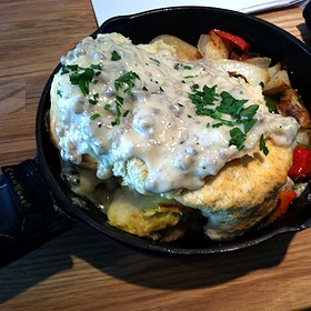 the kitchen sink three eggs scrambled with sausage crumbles cheese signature potatoes peppers and onions topped with homemade jumbo biscuit and - Colonial Cafe Kitchen Sink