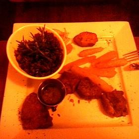 Fried Pork Chunks With Mojo Rice