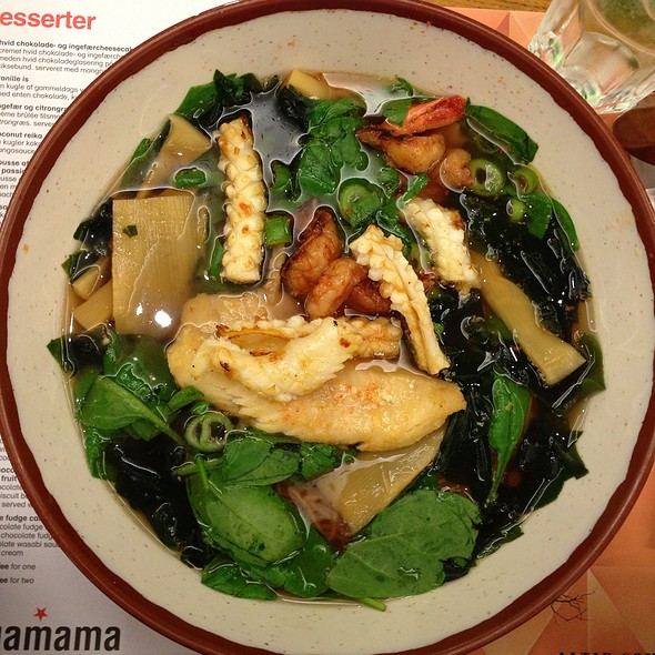 Wagamama Seafood Ramen, Ramen noodles in a vegetable dashi soup topped with grilled black tiger prawns, salmon, basa, squid and seasonal greens. garnished with wakame, menma, seasonal greens and spring onions, one of my all time favorite items.