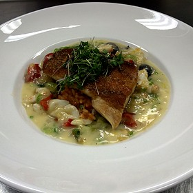 Local Red Fish Over Carolina Red Rice, Blue Crab, Leek, Bibb Sauté, Charred Tomato Butter