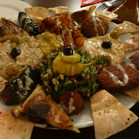 Mezze w. Baba Ghanoush, Potato Haro (Spicy Potato), Fatayer Spinach, Fatoush Salad, Hummus, Falafel and more, served w. pickles olives, tahina sauce & Lebanese bread