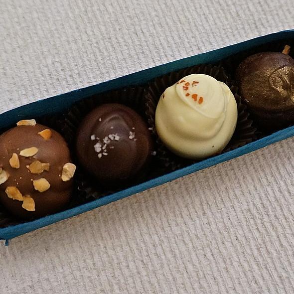 Chocolate truffles, hazelnut, salted caramel, passionfruit ginger, champagne raspberry