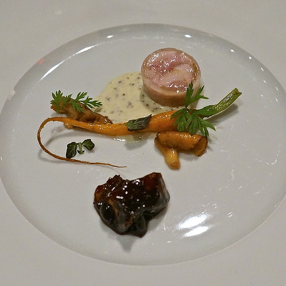 Rabbit loin and belly roulade, braised rabbit thigh, carrots, chanterelles, mustard, Époisses