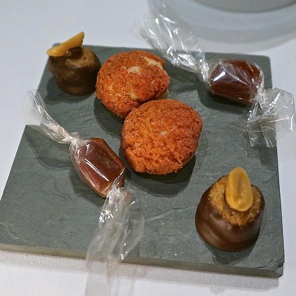 Mignardises, hiscus caramels, cranberry tart tropeziennes (cream puffs), peanut butter crunch truffles
