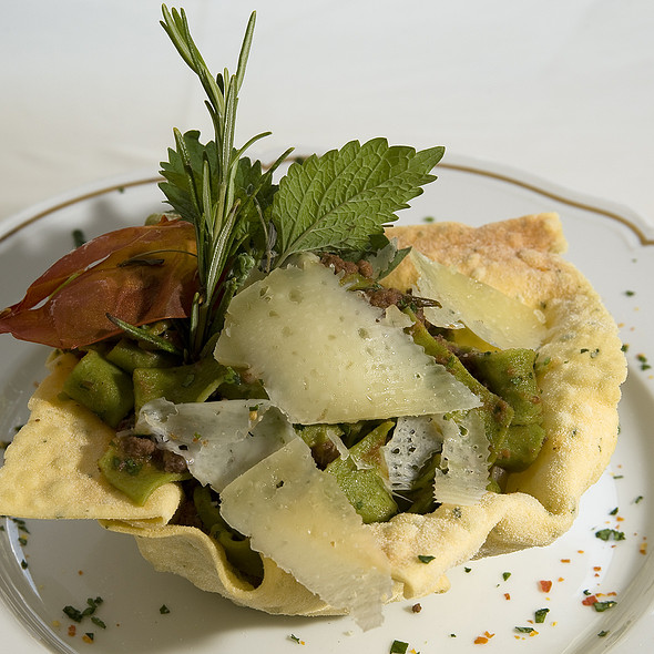 Crispy parmesan basket with home-made pappardelle pasta and Tuscan game sauce @ Relais Le Jardin