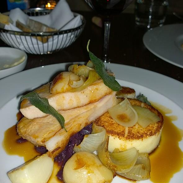 Roast pork loin with parmesan polenta, purple choucroute, baby turnip and cippolini onion leaves - Blink Restaurant, Calgary, AB