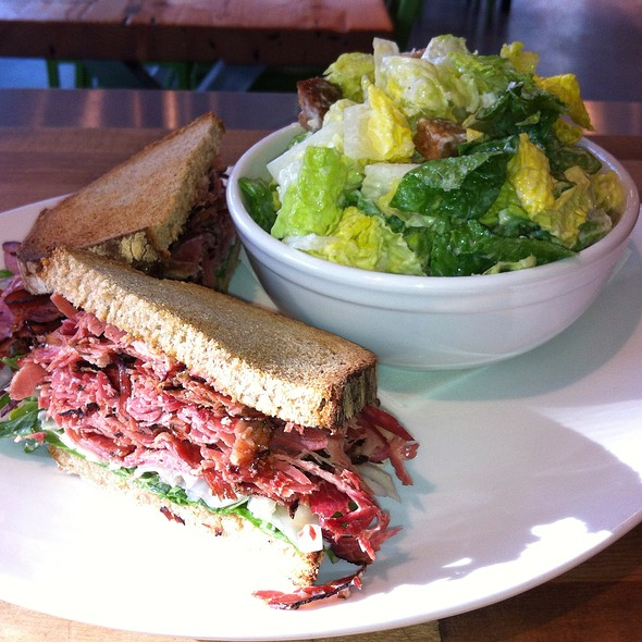 Smoked Meat Sandwich On Rye With Side Romaine Salad