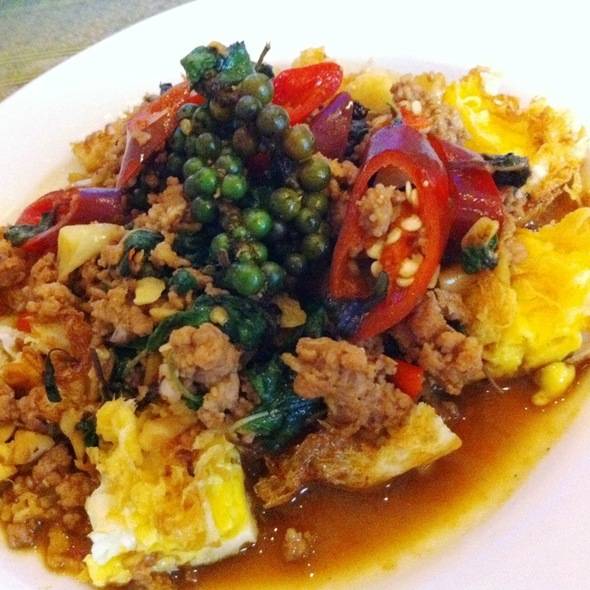 Egg Bomb ไข่ระเบิด (Fried Egg Topped With Minced Pork In Wild Herb & Hot Basil)