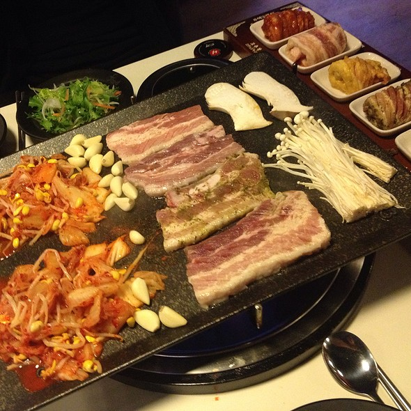 Palsaik set menu: 8 different preparations of pork belly. After you're done grilling, they toss the kimchi and bean sprouts into the remaining seafood soup, along with some rice, to make fried rice @ 팔색삼겹살 Palsaik Samgyupsal Korean BBQ