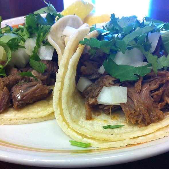 Carnitas and lengua tacos @ El Limon