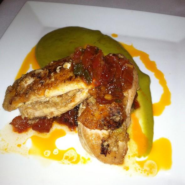 Crispy Skin Free Range Lancaster Chicken, Chorizo corn bread stuffed, poblano butter, smoked tomato jalapeno jam, chili oil - Back Burner Restaurant, Hockessin, DE