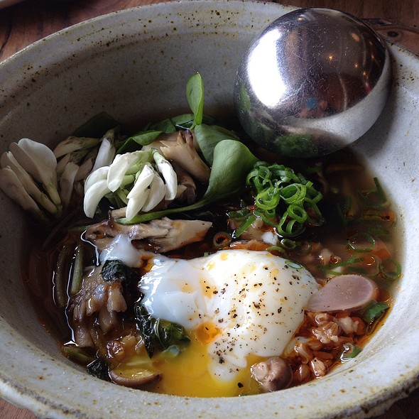Slow Cooked Egg In Mushroom Broth With Barley, Radish, Greens & Fava Bean Flowers