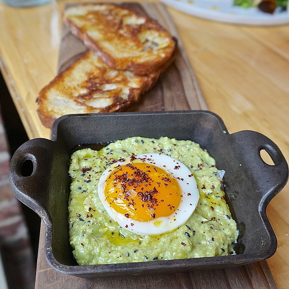 Green hummus, fresh ceci beans, fried egg, sumac, black sesame, toast, olive oil - The Squeaky Bean, Denver, CO