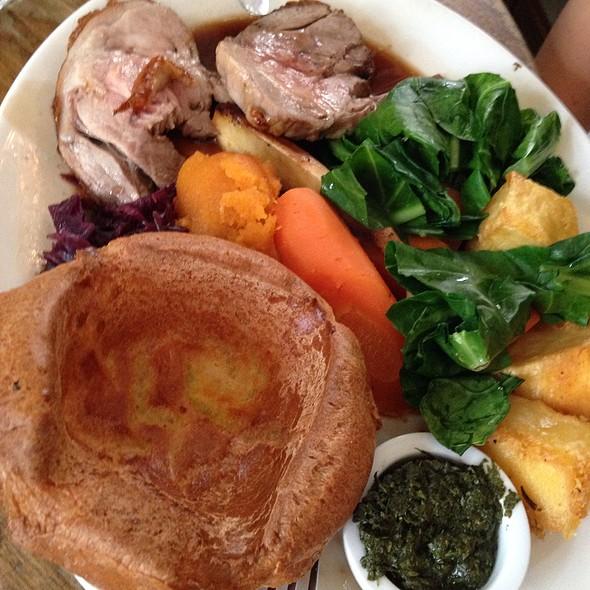 Lamb Sunday Roast With Mint Sauce, Yorkshire Pudding, Roast Potatoes And Greens