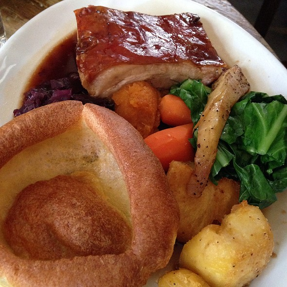 Roast Pork Belly With Crackling, Yorkshire Pudding, Apple Sauce, Roast Potatoes And Greens