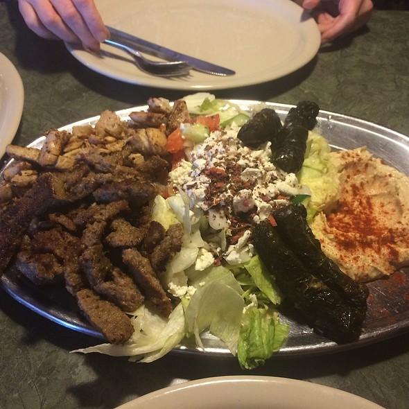 Grape Leaves, Chicken, Gyro, And Greek Salad Sampler Plate @ Rumors