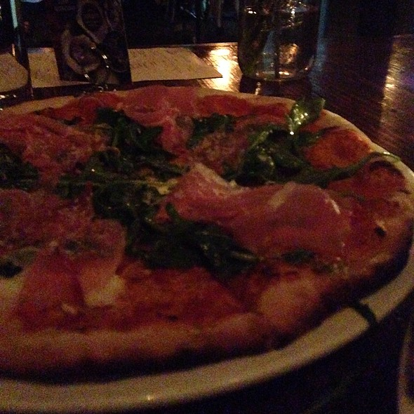 Prosciutto Pizza With Green Chili Pesto And Arugula