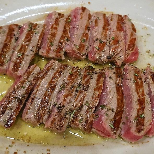 Sliced New York strip, rosemary, lemon, cracked pepper, olive oil, arugula - Anteprima, Chicago, IL