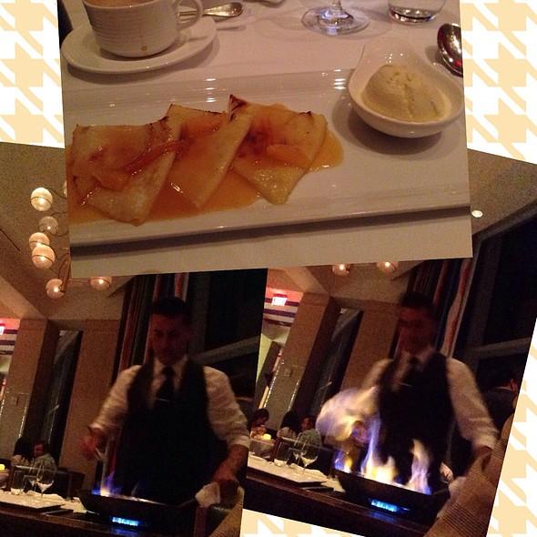 Flambé with orange liquor dulce de leche crep @ Azure