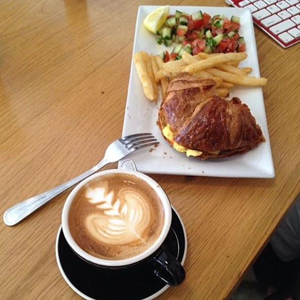 Scrambled eggs in a fresh baked croissant and a capucino - Spiegel, New York, NY