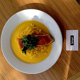 Pan seared salmon over saffron risotto