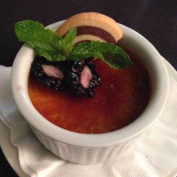 Crème Brulée - Tahitian Vanilla Custard, Wine Poached Plums, Cookie Garnish @ Creme Brasserie
